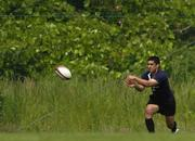 14 June 2005; Scrum-half Kieran Campbell passes the ball during training. Ireland rugby squad training, Tatsumi No Mori Rugby training facility, Tokyo, Japan. Picture credit; Brendan Moran / SPORTSFILE