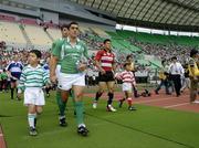 12 June 2005; Kieran Campbell, Ireland, walks onto the pitch with a local mascot before the game. Japan v Ireland 1st Test, Nagai Stadium, Osaka, Japan. Picture credit; Brendan Moran / SPORTSFILE