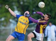9 February 2014; Paddy Brogan, Roscommon, in action against Robert Dempsey, Wexford. Allianz Football League, Division 3, Round 2, Roscommon v Wexford, Kiltoom, Co. Roscommon. Picture credit: David Maher / SPORTSFILE