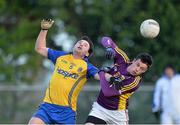 9 February 2014; Paddy Brogan, Roscommon, in action against Robert Dempsey, Wexford. Allianz Football League Division 3 Round 2, Roscommon v Wexford, Kiltoom, Co. Roscommon. Picture credit: David Maher / SPORTSFILE