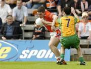 18 June 2005; Brian Mallon, Armagh, in action against Damien Diver, Donegal. Bank of Ireland Ulster Senior Football Championship Replay, Armagh v Donegal, St. Tighernach's Park, Clones, Co. Monaghan. Picture credit; Pat Murphy / SPORTSFILE