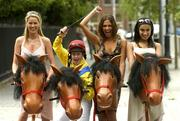23 June 2005; Top Jockey Cathy Gannon with models, from left, Jenny Lee Masterson, Roberta Rowat and Gail Kaneswaran at a photocall ahead of the Budweiser Irish Derby which will take place at the Curragh Racecourse on Sunday, June 26th. Grafton Street, Dublin. Picture credit; Damien Eagers / SPORTSFILE