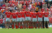 26 June 2005; Armagh team stand for the national anthem. Bank of Ireland Ulster Senior Football Championship Semi-Final, Armagh v Derry, Casement Park, Belfast. Picture Credit; David Maher / SPORTSFILE