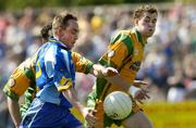 26 June 2005; Thomas Harney, Wicklow, in action against, Damien Diver and Eamon McGee, Donegal. Bank of Ireland All-Ireland Senior Football Championship Qualifier, Round 1, Wicklow v Donegal, County Grounds, Aughrim, Co. Wicklow. Picture Credit; Matt Browne / SPORTSFILE