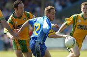 26 June 2005; Thomas Harney, Wicklow, in action against, Damien Diver, left, and Eamon McGee, Donegal. Bank of Ireland All-Ireland Senior Football Championship Qualifier, Round 1, Wicklow v Donegal, County Grounds, Aughrim, Co. Wicklow. Picture Credit; Matt Browne / SPORTSFILE