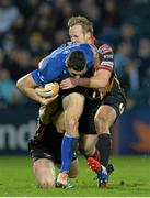 14 February 2014; Noel Reid, Leinster, is tackled by Matthew Pewtner and Ashley Smith, right, Newport Gwent Dragons. Celtic League 2013/14 Round 14, Leinster v Newport Gwent Dragons, RDS, Ballsbridge, Dublin. Picture credit: Ramsey Cardy / SPORTSFILE