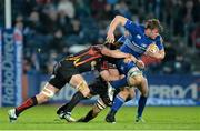 14 February 2014; Jordi Murphy, Leinster, is tackled by Lewis Evans, left, and Netani Talei, Newport Gwent Dragons. Celtic League 2013/14 Round 14, Leinster v Newport Gwent Dragons, RDS, Ballsbridge, Dublin. Picture credit: Ramsey Cardy / SPORTSFILE