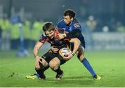 14 February 2014; Matthew Pewtner, Newport Gwent Dragons, is tackled by Zane Kirchner. Celtic League 2013/14 Round 14, Leinster v Newport Gwent Dragons, RDS, Ballsbridge, Dublin. Picture credit: Ray Lohan / SPORTSFILE