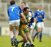 3 July 2005; Damien Diver, Donegal, in action against Peter Reilly, 7, and Pierce Mckenna, Cavan. Bank of Ireland All-Ireland Senior Football Championship Qualifier, Round 2, Cavan v Donegal, Kingspan Breffni Park, Cavan. Picture credit; Pat Murphy / SPORTSFILE