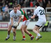 2 February 2014; Michael Foley, Kildare, supported by team-mate David Hyland, right, in action against Adam Gallagher, Mayo. Allianz Football League, Division 1, Round 1, Kildare v Mayo, St Conleth's Park, Newbridge, Co. Kildare. Picture credit: Piaras Ó Mídheach / SPORTSFILE
