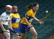 9 July 2005; Catherine O'Loughlin, Clare, in action against Catherine Hayes, Limerick. Munster Junior Camogie Championship Final, Limerick v Clare, Gaelic Grounds, Limerick. Picture credit; Damien Eagers / SPORTSFILE