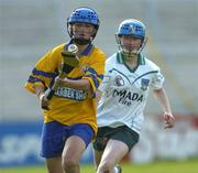 9 July 2005; Laura Linnane, Clare, in action against Mairead Kelly, Limerick. Munster Junior Camogie Championship Final, Limerick v Clare, Gaelic Grounds, Limerick. Picture credit; Damien Eagers / SPORTSFILE