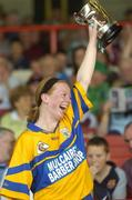 9 July 2005; Deirdre Murphy, Clare, lifts the cup. Munster Junior Camogie Championship Final, Limerick v Clare, Gaelic Grounds, Limerick. Picture credit; Damien Eagers / SPORTSFILE