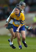 9 July 2005; Catherine O'Loughlin, Clare, in action against Sarah Collins, Limerick. Munster Junior Camogie Championship Final, Limerick v Clare, Gaelic Grounds, Limerick. Picture credit; Damien Eagers / SPORTSFILE