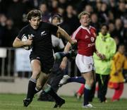 9 July 2005; Conrad Smith, New Zealand, gets around the tackle of Geordan Murphy, British and Irish Lions, on his way to scoring a try. British and Irish Lions Tour to New Zealand 2005, 3rd Test, New Zealand v British and Irish Lions, Eden Park, Auckland, New Zealand. Picture credit; Brendan Moran / SPORTSFILE
