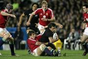 9 July 2005; Byron Kelleher, New Zealand, is tackled by Donnacha O'Callaghan, British and Irish Lions. British and Irish Lions Tour to New Zealand 2005, 3rd Test, New Zealand v British and Irish Lions, Eden Park, Auckland, New Zealand. Picture credit; Brendan Moran / SPORTSFILE