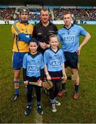 23 February 2014; Mascots Éile O Ceallaigh, age 11, left, and Aishling Cullen, age 10, from Whitehall, Dublin, with referee Alan Kelly, Clare captain Patrick Donnellan and Dublin captain John McCaffrey before the game. Allianz Hurling League Division 1A Round 2, Dublin v Clare, Parnell Park, Dublin. Picture credit: Stephen McCarthy / SPORTSFILE