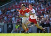 10 July 2005; Andy Mallon, Armagh, in action against Martin Penrose, Tyrone. Bank of Ireland Ulster Senior Football Championship Final, Armagh v Tyrone, Croke Park, Dublin. Picture credit; Ray McManus / SPORTSFILE