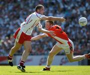 10 July 2005; Stephen O'Neill, Tyrone, in action against Francie Bellew, Armagh. Bank of Ireland Ulster Senior Football Championship Final, Armagh v Tyrone, Croke Park, Dublin. Picture credit; Ray McManus / SPORTSFILE