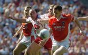 10 July 2005; Tony McEntee, Armagh, in action against Brian Dooher, Tyrone. Bank of Ireland Ulster Senior Football Championship Final, Armagh v Tyrone, Croke Park, Dublin. Picture credit; Ray McManus / SPORTSFILE