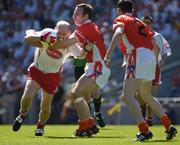 10 July 2005; Armagh's  Enda McNulty, supported by Andy Mallon, 2, tackles Peter Canavan, Tyrone. Bank of Ireland Ulster Senior Football Championship Final, Armagh v Tyrone, Croke Park, Dublin. Picture credit; Ray McManus / SPORTSFILE