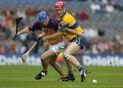 24 July 2005; Michael Jordan, Wexford, is tackled by Brian Lohan, Clare. Guinness All-Ireland Senior Hurling Championship Quarter-Final, Wexford v Clare, Croke Park, Dublin. Picture credit; Ray McManus / SPORTSFILE