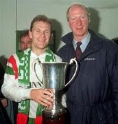 22 May 1993; Cork City captain Declan Daly celebrates with the Premier Division trophy and Republic of Ireland manager Jack Charlton after the Harp Lager National League Premier Division Final play-off match between Shelbourne and Cork City at the RDS Arena in Dublin. Photo by David Maher/Sportsfile