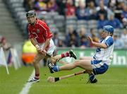 24 July 2005; Ben O'Connor, Cork, in action against James Murray, Waterford. Guinness All-Ireland Senior Hurling Championship Quarter-Final, Cork v Waterford, Croke Park, Dublin. Picture credit; Ray McManus / SPORTSFILE