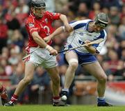 24 July 2005; Tom Feeney, Waterford, in action against Ben O'Connor, Cork. Guinness All-Ireland Senior Hurling Championship Quarter-Final, Cork v Waterford, Croke Park, Dublin. Picture credit; Ray McManus / SPORTSFILE