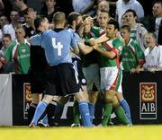 15 August 2005; Shelbourne and Cork City players scuffle after referee Damien Hancock had sent off Shelbourne's Richie Baker. eircom League, Premier Division, Cork City v Shelbourne, Turners Cross, Cork. Picture credit; David Maher / SPORTSFILE