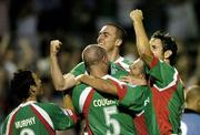 15 August 2005; Winning goalscorer Neal Horgan, centre top, Cork City, celebrates at the end with team-mates left to right, Danny Murphy, Derek Coughlan, Greg O'Halloran and Alan Bennett, after victory over Shelbourne. eircom League, Premier Division, Cork City v Shelbourne, Turners Cross, Cork. Picture credit; David Maher / SPORTSFILE