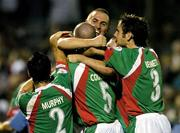 15 August 2005; Winning goalscorer Neal Horgan, centre top, Cork City, celebrates at the end with team-mates left to right, Danny Murphy, Derek Coughlan and Alan Bennett, after victory over Shelbourne. eircom League, Premier Division, Cork City v Shelbourne, Turners Cross, Cork. Picture credit; David Maher / SPORTSFILE