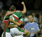 15 August 2005; Winning goalscorer Neal Horgan, centre, Cork City, celebrates at the end with team-mates left to right, Danny Murphy and Alan Bennett, as Colin Hawkins, Shelbourne looks on. eircom League, Premier Division, Cork City v Shelbourne, Turners Cross, Cork. Picture credit; David Maher / SPORTSFILE