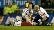 25 June 2005; British and Irish Lions captain Brian O'Driscoll is attended to by team doctor Dr. James Robson, centre, before leaving the field with a suspected dislocated shoulder. British and Irish Lions Tour to New Zealand 2005, 1st Test, New Zealand v British and Irish Lions, Jade Stadium, Christchurch, New Zealand. Picture credit; Brendan Moran / SPORTSFILE