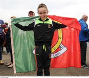 29 May 2016; Mayo supporter Eoin Murphy, age 11, Charlestown, Co. Mayo, hold a county flag ahead of the Connacht GAA Football Senior Championship quarter-final between London and Mayo in Páirc Smárgaid, Ruislip, London, England. Photo by Seb Daly/Sportsfile