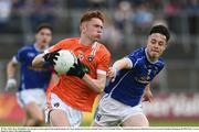 29 May 2016; Ross McQuillan of Armagh in action against Darragh Kennedy of Cavan during the Electric Ireland Ulster GAA Football Minor Championship quarter-final between Cavan and Armagh in Kingspan Breffni Park, Cavan. Photo by Oliver McVeigh/Sportsfile
