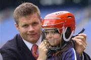 23 August 2005; Azzurri today promoted their hurling helmet. The Azzurri CE marked helmet design was developed with the assistance of county players and the GPA. At the promotion is Dessie Farrell of the GPA assisting young hurler Sarah White, age 7, form Offaly. Croke Park, Dublin. Picture credit; Brian Lawless / SPORTSFILE