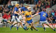 9 March 2014; Conor McGrath, Clare, tries to evade Tipperary's Paddy Stapleton, while Shane McGrath, left, and Cathal Barrett try to keep up. Allianz Hurling League, Division 1A, Round 3, Tipperary v Clare, Semple Stadium, Thurles, Co. Tipperary. Picture credit: Brendan Moran / SPORTSFILE