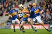 9 March 2014; Conor McGrath, Clare, in action against Paddy Stapleton and Shane McGrath, right, Tipperary. Allianz Hurling League, Division 1A, Round 3, Tipperary v Clare, Semple Stadium, Thurles, Co. Tipperary. Picture credit: Brendan Moran / SPORTSFILE