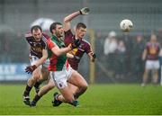 9 March 2014; Aidan O'Shea, Mayo, in action against John Gilligan, left, and John Heslin, Westmeath. Allianz Football League Division 1 Round 4, Westmeath v Mayo, Cusack Park, Mullingar, Co. Westmeath. Picture credit: Paul Mohan / SPORTSFILE