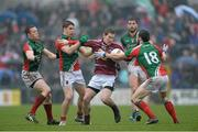 9 March 2014; Gavin Hoey, Westmeath, in action against Mayo's Donal Vaughan, left, Lee Keegan, and David Drake, right. Allianz Football League Division 1 Round 4, Westmeath v Mayo, Cusack Park, Mullingar, Co. Westmeath. Picture credit: Paul Mohan / SPORTSFILE
