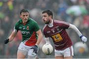 9 March 2014; Paul Sharry, Westmeath, in action against Jason Doherty, Mayo. Allianz Football League Division 1 Round 4, Westmeath v Mayo, Cusack Park, Mullingar, Co. Westmeath. Picture credit: Paul Mohan / SPORTSFILE