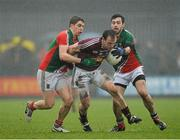 9 March 2014; John Gilligan, Westmeath, in action against Lee Keegan, left, and Kevin McLoughlin, Mayo. Allianz Football League Division 1 Round 4, Westmeath v Mayo, Cusack Park, Mullingar, Co. Westmeath. Picture credit: Paul Mohan / SPORTSFILE