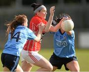 9 March 2014; Grace Kearney, Cork, in action against Siobhan McGrath, left, and Niamh McEvoy, Dublin. Tesco Homegrown Ladies National Football League Division 1 Round 5, Dublin v Cork, Parnell Park, Dublin. Picture credit: Pat Murphy / SPORTSFILE