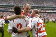 4 September 2005; Mickey Harte, Tyrone, manager is embraced by Ryan McMenamin, (2) and Chris Lawn after victory over Armagh. Bank of Ireland All-Ireland Senior Football Championship Semi-Final, Armagh v Tyrone, Croke Park, Dublin. Picture credit; Damien Eagers / SPORTSFILE