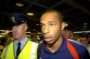 6 September 2005; Thierry Henry, member of the French squad, with Paul Clarke, left, a member of the Aiport police and current selector of the Dublin football team, pictured on arrival at Dublin Airport in advance of the World Cup Qualifying game against the Republic of Ireland. Dublin Airport, Dublin. Picture credit; Damien Eagers / SPORTSFILE