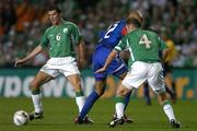 7 September 2005; Roy Keane, left, and Kenny Cunninghan (4), Republic of Ireland, combine to dispossess Thierry Henry, France. FIFA 2006 World Cup Qualifier, Group 4, Republic of Ireland v France, Lansdowne Road, Dublin. Picture credit; Brendan Moran / SPORTSFILE