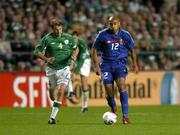 7 September 2005; Thierry Henry, France, in action against Kenny Cunningham, Republic of Ireland. FIFA 2006 World Cup Qualifier, Group 4, Republic of Ireland v France, Lansdowne Road, Dublin. Picture credit; Brian Lawless / SPORTSFILE