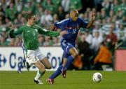 7 September 2005; Thierry Henry, France, in action against John O'Shea, Republic of Ireland. FIFA 2006 World Cup Qualifier, Group 4, Republic of Ireland v France, Lansdowne Road, Dublin. Picture credit; Brendan Moran / SPORTSFILE