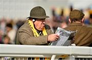 11 March 2014; Racegoer Sid Piccou, from London, studies the form ahead of the day's races. Cheltenham Racing Festival 2014. Prestbury Park, Cheltenham, England. Picture credit: Barry Cregg / SPORTSFILE - read more